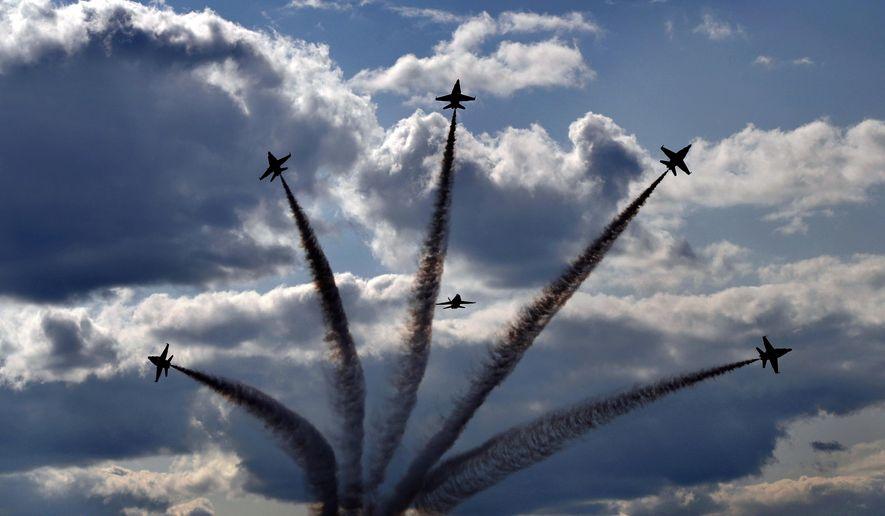 The U.S. Navy Blue Angels demonstration team perform Saturday, Aug. 26, 2017, at the Great State of Maine Air Show at the former Brunswick Naval Air Station, in Brunswick, Maine in this file photo. (AP Photo/Robert F. Bukaty) **FILE**