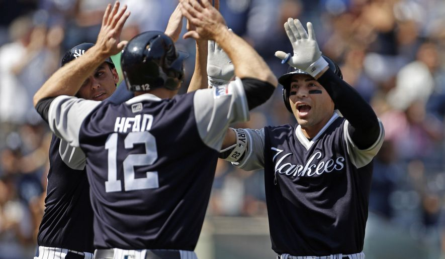 New York Yankees Jacoby Ellsbury, right, celebrates a three-run home run with Chase Headley (12) and Greg Bird during the fourth inning of a baseball game against the Seattle Mariners on Saturday, Aug. 26, 2017, in New York. (AP Photo/Adam Hunger)