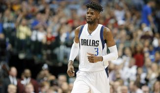 This March 23, 2017 photo shows Dallas Mavericks forward Nerlens Noel running up court during an NBA basketball game against the Los Angeles Clippers in Dallas. Two people with knowledge of the agreement say Noel has accepted a $4.1 million qualifying offer for one year, essentially betting on himself that he can get something closer to a max contract as an unrestricted free agent next summer. Noel's decision as a restricted free agent means he can't sign a long-term deal until after the upcoming season, one of the people told The Associated Press on Saturday, Aug. 26, 2017. (AP Photo/Tony Gutierrez)