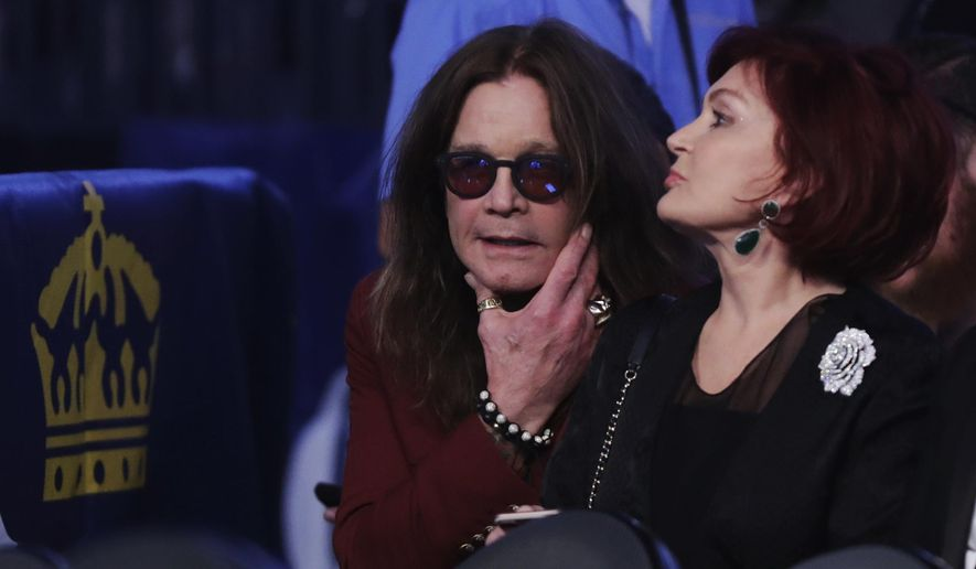 Ozzy Osbourne, left, and his wife Sharon wait for the super welterweight boxing match between Floyd Mayweather Jr. and Conor McGregor, Saturday, Aug. 26, 2017, in Las Vegas. (AP Photo/Isaac Brekken) ** FILE **