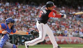 Washington Nationals' Adrian Sanchez, right, hits a two-run RBI-single during the first inning of a baseball game against the New York Mets, Saturday, Aug. 26, 2017, in Washington. (AP Photo/Mark Tenally)