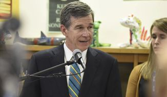 In this Feb. 22, 2017 file photo, North Carolina Gov. Roy Cooper speaks at Bradley Creek Elementary School in Wilmington, N.C. (Matt Born/The Star-News via AP) **FILE**