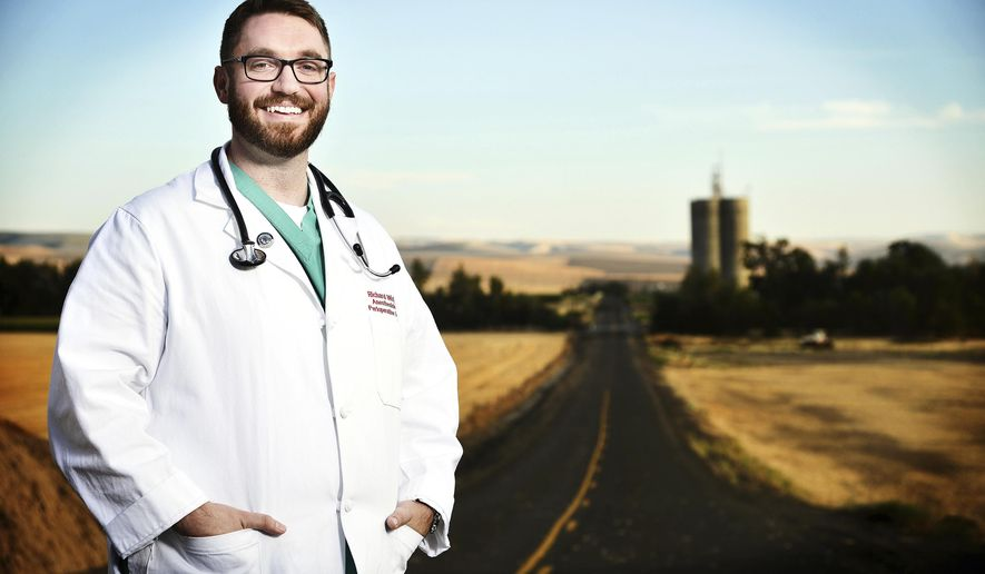 This August 15, 2017 photo shows Richard Wick, an anesthesiologist at Providence St. Mary Medical Center in Walla Walla, Wash. Wick, who grew up in Pendleton, dreamed of being a doctor since boyhood and practicing in a rural area was always on the radar. (E.J. Harris/East Oregonian via AP)
