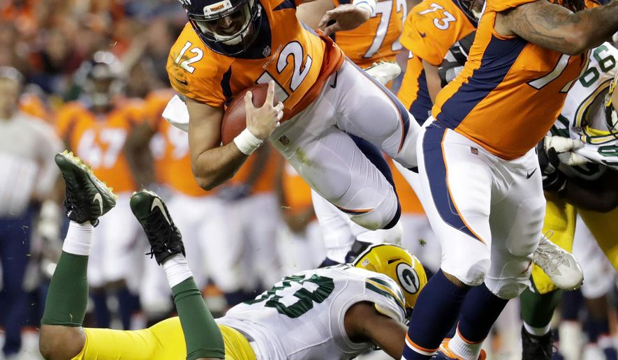 533616d6233 Denver Broncos quarterback Paxton Lynch (12) is upended by Green Bay Packers  linebacker Reggie