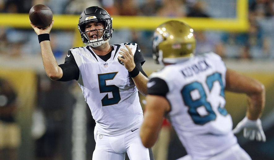 Jacksonville Jaguars quarterback Blake Bortles (5) throws a pass to tight end Ben Koyack (83) during the second half of an NFL preseason football game against the Carolina Panthers, Thursday, Aug. 24, 2017, in Jacksonville, Fla. (AP Photo/Stephen B. Morton)
