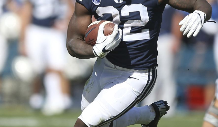 BYU running back Squally Canada (22)in the second half of an NCAA college football game against Portland State, Saturday, Aug. 26, 2017, in Provo, Utah. (AP Photo/Rick Bowmer)