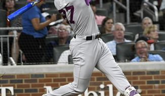 Colorado Rockies shortstop Trevor Story hits a two run line drive double to centerfield during the fifth inning of a baseball game against the Atlanta Braves, Saturday, Aug. 26, 2017, in Atlanta. Gerardo Parra and Mark Reynolds scored. (AP Photo/John Amis)