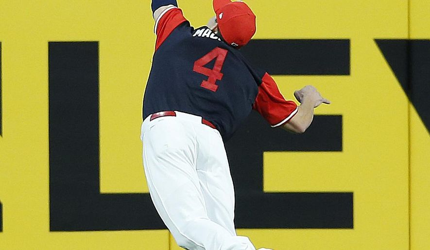 Cleveland Indians' Bradley Zimmer makes a diving catch to get out Kansas City Royals' Lorenzo Cain during the fifth inning in a baseball game, Saturday, Aug. 26, 2017, in Cleveland. (AP Photo/Ron Schwane)