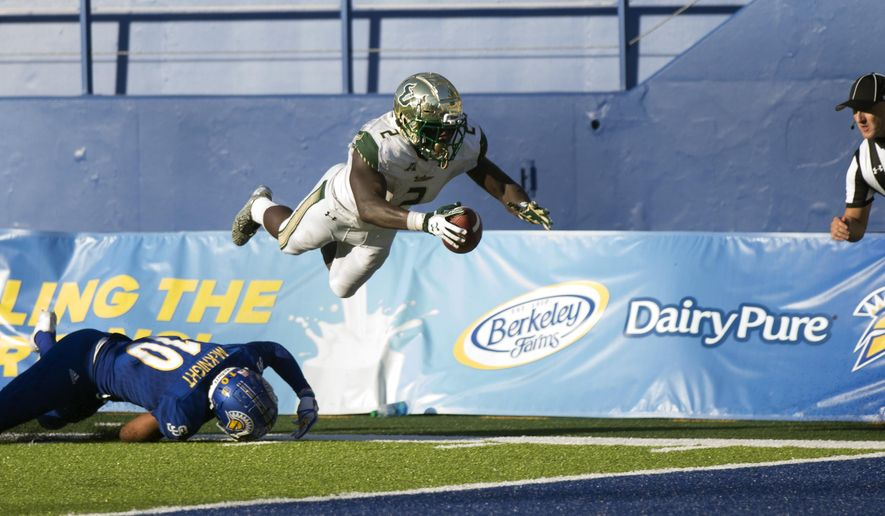 South Florida's D'Earnest Johnson (2) leaps over San Jose State defender Maurice McKnight (10) for a touchdown during the second quarter of an NCAA college football game, Saturday, Aug. 26, 2017, in San Jose, Calif. (AP Photo/D. Ross Cameron)
