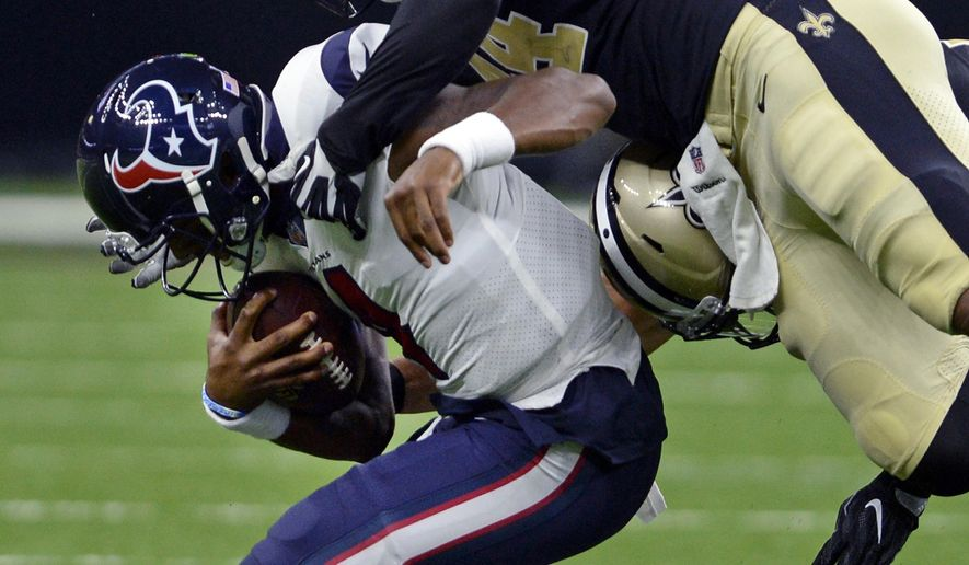 Houston Texans quarterback Deshaun Watson is brought down by New Orleans Saints outside linebacker Hau'oli Kikaha (44) in the first half of a preseason NFL football game in New Orleans, Saturday, Aug. 26, 2017. (AP Photo/Bill Feig)
