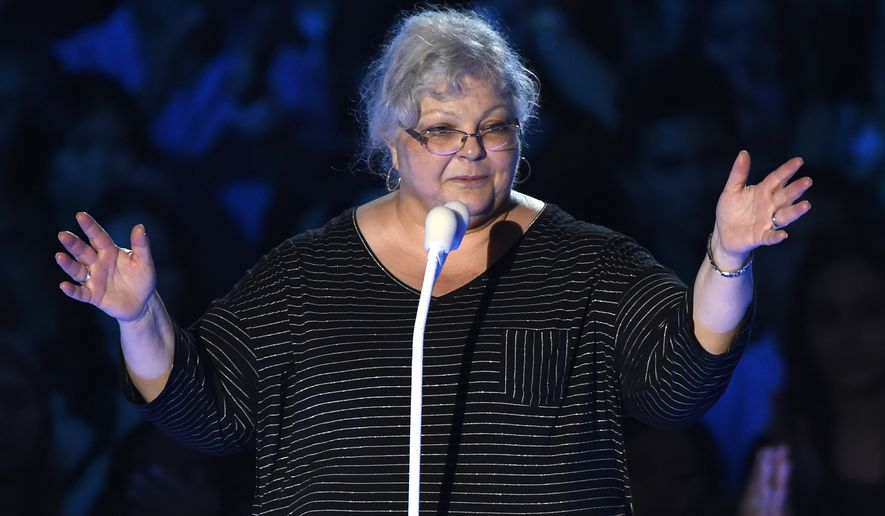 Susan Bro, mother of Heather Heyer, speaks at the MTV Video Music Awards at The Forum on Sunday, Aug. 27, 2017, in Inglewood, Calif. Heyer was killed in Charlottesville, Va., after a car crashed into demonstrators protesting a white supremacy rally. (Photo by Chris Pizzello/Invision/AP)