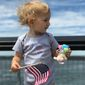 The American Civil Liberties Union tweeted this photo Wednesday of a white baby holding a U.S. flag. (ACLU)