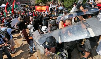 White nationalist demonstrators use shields as they clash with counter demonstrators at the entrance to Lee Park in Charlottesville, Virginia, on Aug. 12. (Associated Press)