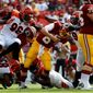 Washington Redskins quarterback Kirk Cousins is sacked by the Cincinnati Bengals in the first half of their preseason game on Sunday. Cousins was sacked twice, both times on third down, where the Redskins converted only 4-of-13 opportunities in the 23-17 victory. (Associated Press)