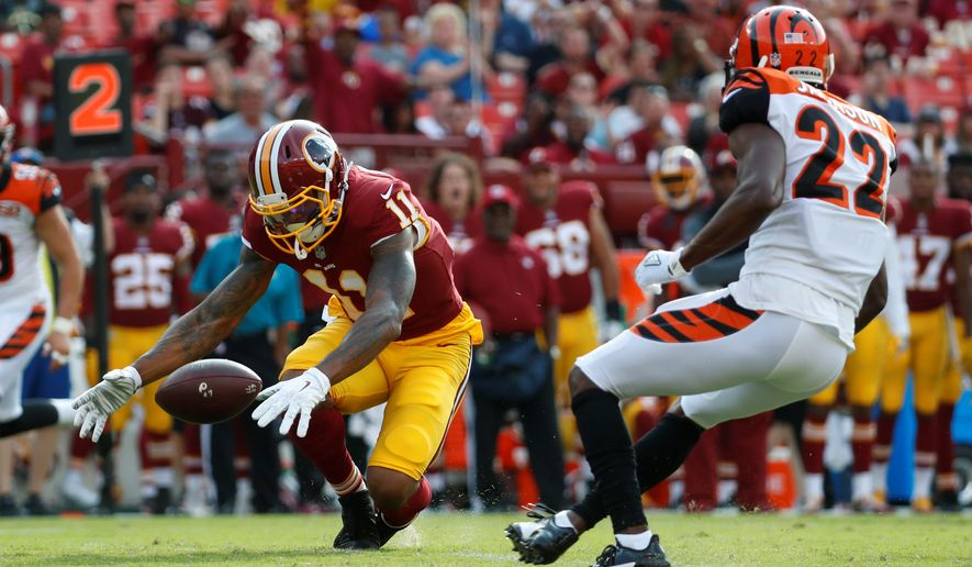 Washington Redskins wide receiver Terrelle Pryor is unable to hold onto a pass in front of Cincinnati Bengals cornerback William Jackson in the first half on Sunday. Pryor dropped a couple of throws and finished with just one catch on four targets. (Associated Press)