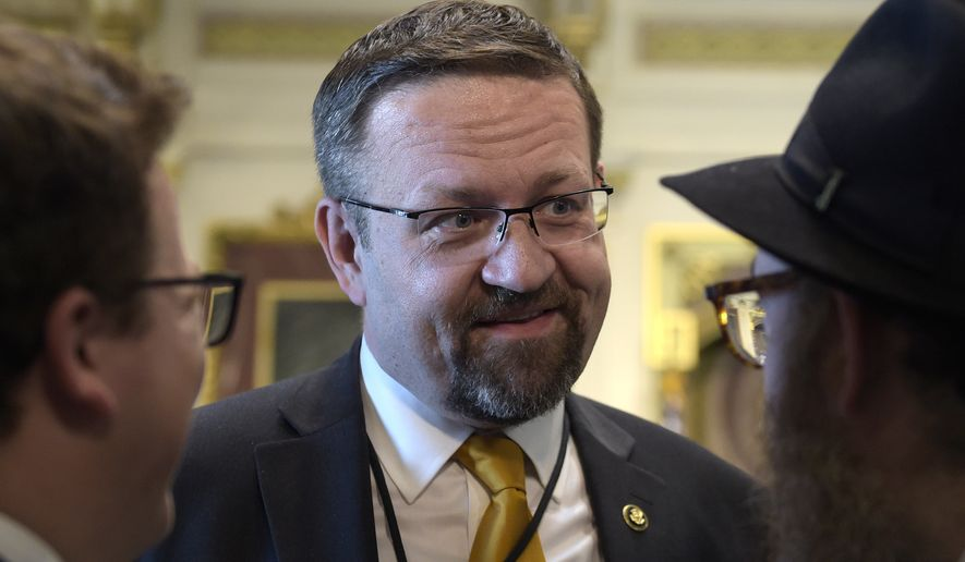 Deputy assistant to President Trump, Sebastian Gorka, talks with people in the Treaty Room in the Eisenhower Executive Office Building on the White House complex in Washington during a ceremony commemorating Israeli Independence Day. White House national security aide Sebastian Gorka tells The Associated Press he has resigned from his position, Friday, Aug. 25, 2017. (AP Photo/Susan Walsh, File)