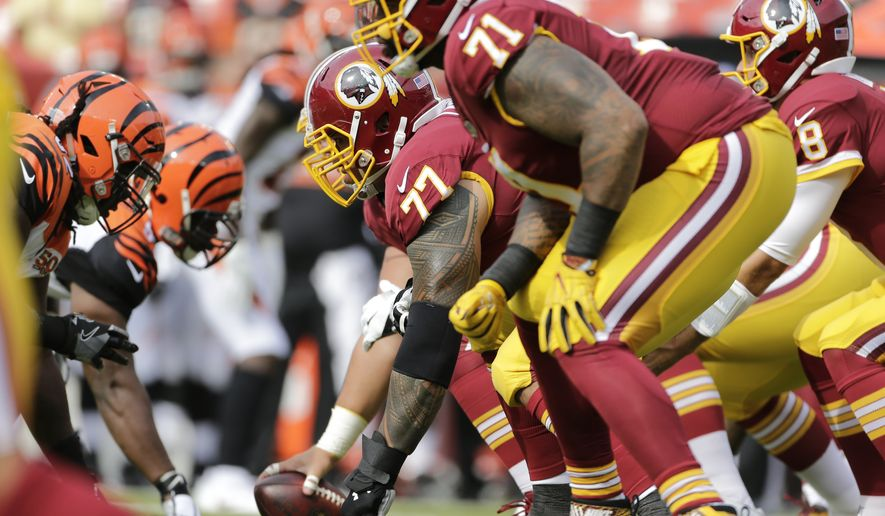 Washington Redskins offensive line at the line scrimmage during a preseason NFL football game between the Cincinnati Bengals and Washington Redskins, Sunday, Aug. 27, 2017, in Landover, Md. (AP Photo/Mark Tenally)