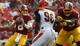 Washington Redskins quarterback Kirk Cousins (8) looks for a receiver in the first half of a preseason NFL football game against the Cincinnati Bengals, Sunday, Aug. 27, 2017, in Landover, Md. (AP Photo/Alex Brandon)