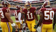 Washington Redskins wide receiver Terrelle Pryor (11) runs past teammates after being introduced before a preseason NFL football game against the Cincinnati Bengals, Sunday, Aug. 27, 2017, in Landover, Md. (AP Photo/Alex Brandon)