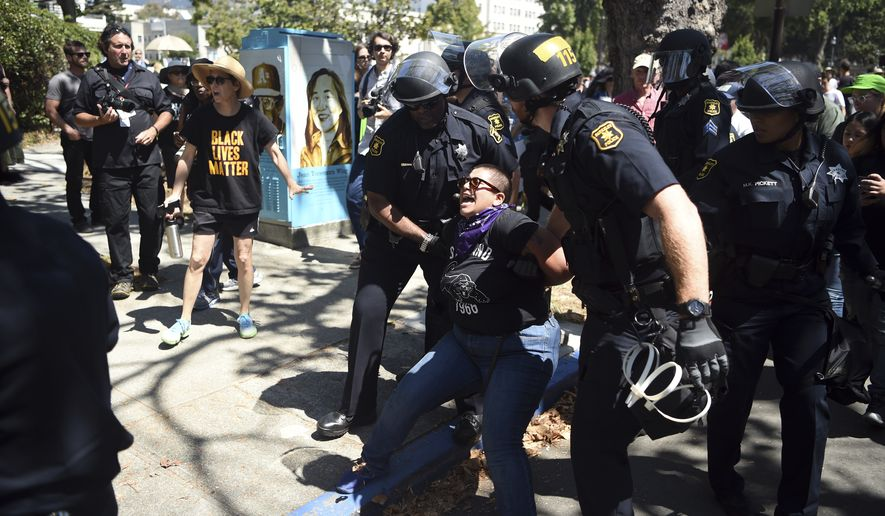 A demonstrator is arrested during a free speech rally Sunday, Aug. 27, 2017, in Berkeley, Calif. (AP Photo/Josh Edelson)