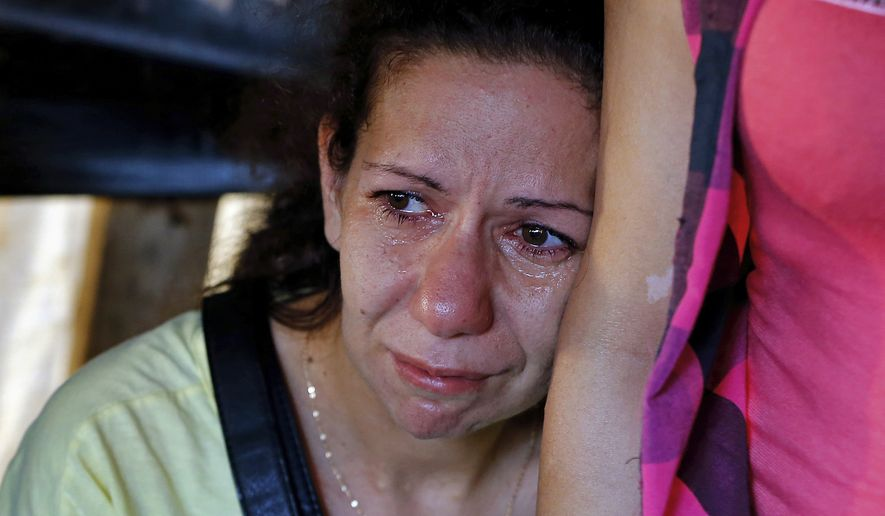 This woman has learned that a missing relative was among the soldiers killed after Islamic State militants kidnapped them three years ago when the Syrian civil war spilled over into Lebanon. (Associated Press/File)