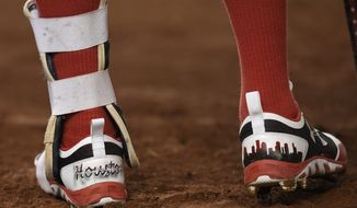 """The cleats of Washington Nationals' Anthony Rendon have """"Houston"""" written on them as he stands on-deck during the fourth inning of the second baseball game of a split doubleheader against the New York Mets, Sunday, Aug. 27, 2017, in Washington. (AP Photo/Nick Wass)"""