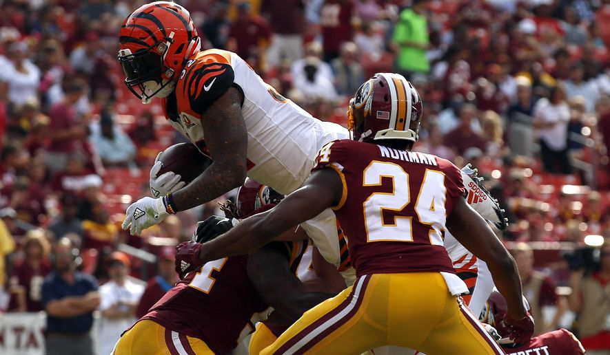 Cincinnati Bengals running back Jeremy Hill, left, dives into the end zone for a touchdown in front of Washington Redskins cornerback Josh Norman (24) in the first half of a preseason NFL football game, Sunday, Aug. 27, 2017, in Landover, Md. (AP Photo/Alex Brandon)
