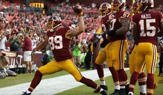Washington Redskins tight end Derek Carrier (89) spikes the ball in front of teammates after scoring a touchdown in the second half of a preseason NFL football game against the Cincinnati Bengals, Sunday, Aug. 27, 2017, in Landover, Md. (AP Photo/Alex Brandon)