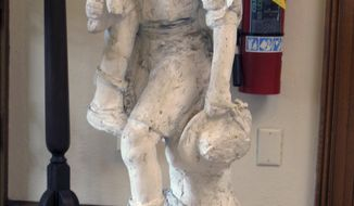 This Aug. 21, 2017 photo shows a plaster model of a Boy Scout carrying another scout in Barre, Vt., which was to have served as the model for a granite statue. The project was abandoned in 1941 after the death of the original artist. Now people in the community are working to finish the project. (AP Photo/Wilson Ring)
