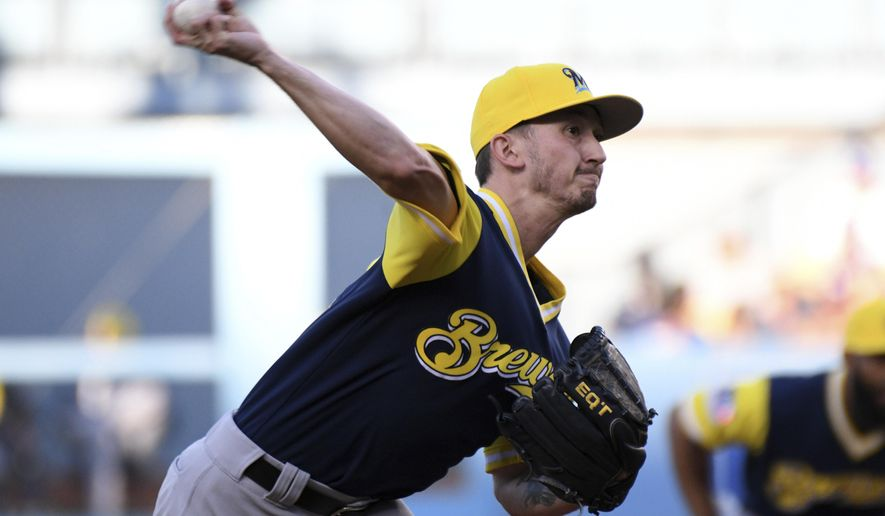 Milwaukee Brewers pitcher Zach Davies throws during the first inning of a baseball game against the Los Angeles Dodgers, Saturday, Aug. 26, 2017, in Los Angeles. (AP Photo/Michael Owen Baker)