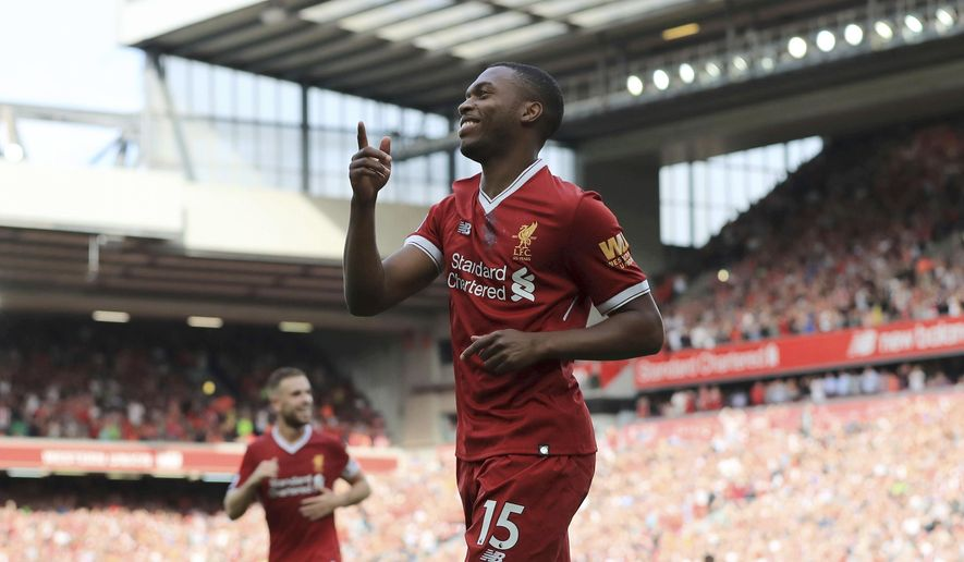 Liverpool's Daniel Sturridge celebrates scoring his side's fourth goal of the game against Arsenal during their English Premier League soccer match at Anfield, Liverpool, England, Sunday Aug. 27, 2017. (Peter Byrne/PA via AP)