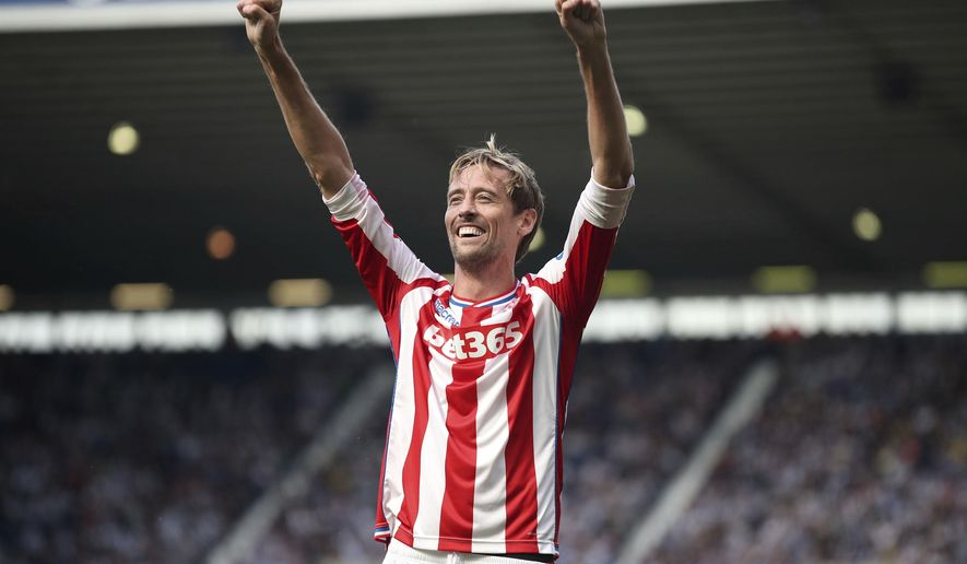 Stoke City's Peter Crouch celebrates scoring his side's first goal of the game against West Bromwich during their English Premier League soccer match at The Hawthorns, West Bromwich, England, Sunday Aug. 27, 2017. (Nick Potts/PA via AP)