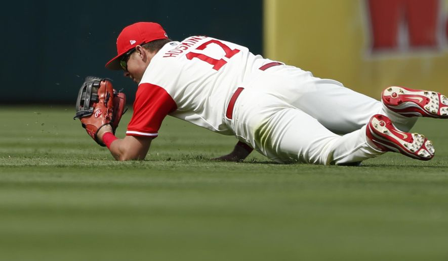 Philadelphia Phillies left fielder Rhys Hoskins (17) catches a line drive by Chicago Cubs Javier Baez before throwing to second base for a triple play in the fifth inning of a baseball game, Sunday, Aug. 27, 2017, in Philadelphia. (AP Photo/Laurence Kesterson)