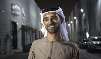 In this Aug. 18, 2017 photo, Emirati filmmaker Abdulla Al Kaabi speaks to The Associated Press in Dubai after screening his film Only Men Go To The Grave. In his debut feature film, Al Kaabi reveals traditional Arab characters grappling with issues of homosexual love, gender identity, drug abuse, sectarianism and women's rights. (AP Photo/Razan Alzayani)