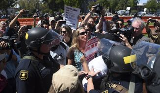 "Demonstrators clash during a free speech rally Sunday, Aug. 27, 2017, in Berkeley, Calif. Several thousand people converged in Berkeley Sunday for a ""Rally Against Hate"" in response to a planned right-wing protest that raised concerns of violence and triggered a massive police presence. Several people were arrested for violating rules against covering their faces or carrying items banned by authorities. (AP Photo/Josh Edelson)"
