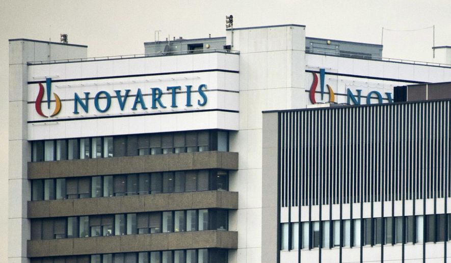 This Oct. 25, 2011, file photo shows the logo of Swiss pharmaceutical company Novartis AG on one of their buildings in Basel, Switzerland. (Georgios Kefalas/Keystone via AP, File)