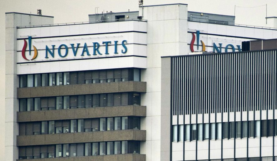 FILE - This Oct. 25, 2011 file photo shows the logo of Swiss pharmaceutical company Novartis AG on one of their buildings in Basel, Switzerland. According to results published Sunday, Aug. 27, 2017, for the first time, a drug has helped prevent heart attacks by curbing inflammation, a new and very different approach than lowering cholesterol, which has been the main focus for decades. Canakinumab's maker, Novartis, sponsored the study. (Georgios Kefalas/Keystone via AP, File)