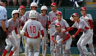 Japan's Keitaro Miyahara (10) is greeted by teammates after hitting a solo home run off Lufkin, Texas' Chip Buchanan in the fourth inning of the Little League World Series Championship baseball game in South Williamsport, Pa., Sunday, Aug. 27, 2017. (AP Photo/Gene J. Puskar). **FILE**