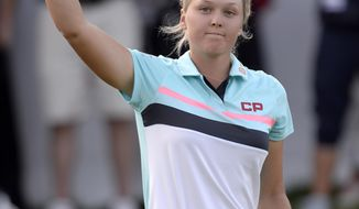 Brooke Henderson, of Canada, salutes the crowd after finishing up on the 18th hole during the final round of the Canadian Pacific Women's Open golf tournament in Ottawa, Ontario, Sunday, Aug. 27, 2017. (Adrian Wyld/The Canadian Press via AP)
