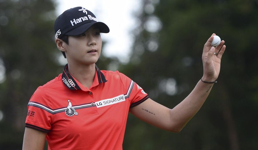 South Korea's Sung Hyun Park holds up her ball after sinking a birdie putt on the 18th hole during final round action at the 2017 Canadian Pacific Women's Open in Ottawa on Sunday, Aug. 27, 2017. (Sean Kilpatrick/The Canadian Press via AP)