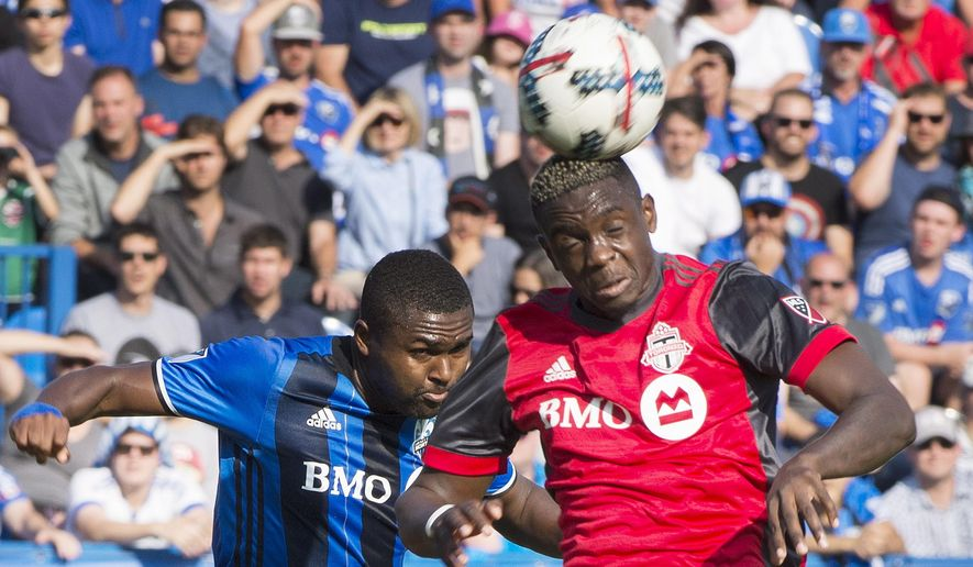 Montreal Impact's Chris Duvall, left, challenges Toronto FC's Chris Mavinga during first half MLS soccer action in Montreal, Sunday, Aug. 27, 2017. (Graham Hughes/The Canadian Press via AP)