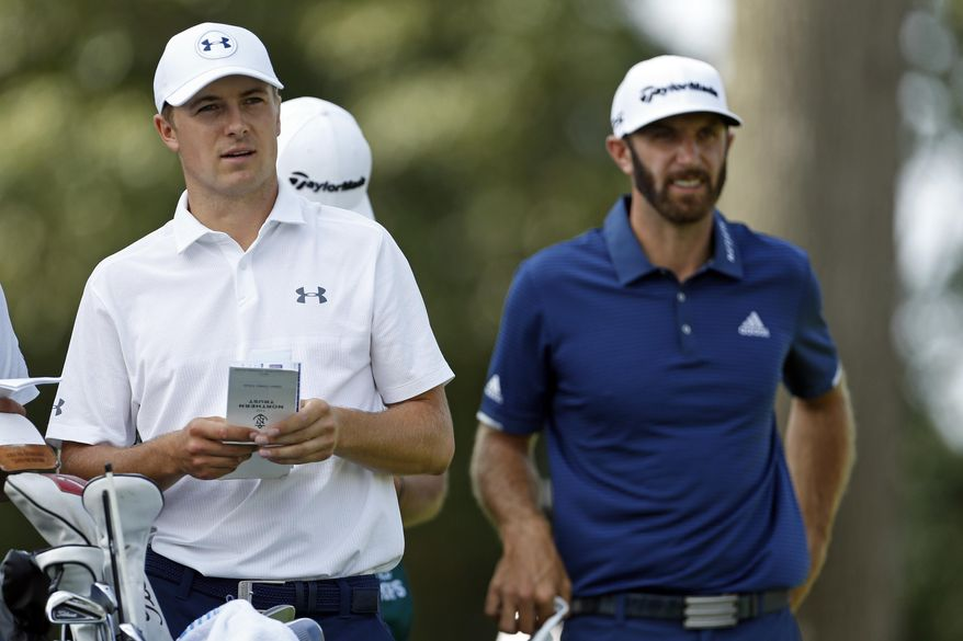 Jordan Spieth, left, and Dustin Johnson look out on the second hole from the tee box during final round play at The Northern Trust golf tournament on Sunday, Aug. 27, 2017, in Old Westbury, N.Y. (AP Photo/Adam Hunger)