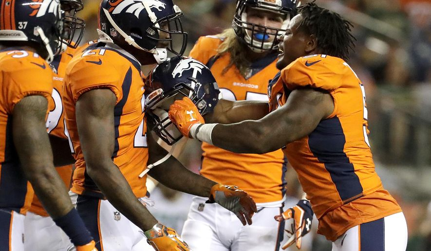 Denver Broncos inside linebacker Todd Davis, right, shoves teammate Aqib Talib (21) after getting into an altercation against the Green Bay Packers during the first half of an NFL preseason football game, Saturday, Aug. 26, 2017, in Denver. (AP Photo/Jack Dempsey)