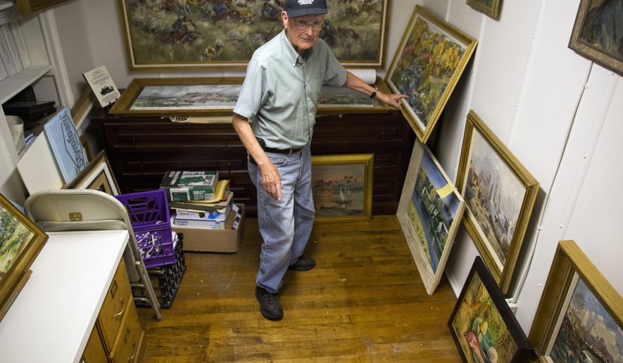 FILE - In this Thursday, June 29, 2017 photo Leroy Jazwick talks about the collection of Archie B. Teater paintings at the Hagerman Valley Historical Society Museum in Hagerman, Idaho. Teater an Idaho-born landscape painter who traveled the world on the strength of his sales, had one-man shows in New York and commissioned a studio by famed architect Frank Lloyd Wright is mostly forgotten now. Except by a southern Idaho historical society that owns about 600 of Archie Teater's oil-on-canvas paintings and hopes to revive demand for his work. (Pat Sutphin /The Times-News via AP, File)