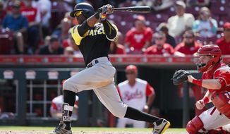 Pittsburgh Pirates' Starling Marte hits a two-run single off Cincinnati Reds relief pitcher Raisel Iglesias in the ninth inning of a baseball game, Sunday, Aug. 27, 2017, in Cincinnati.  (AP Photo/John Minchillo)