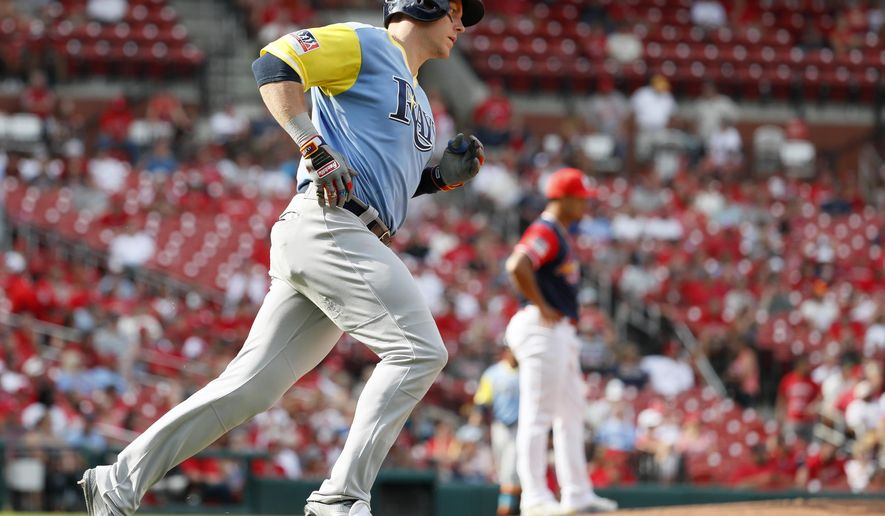 Tampa Bay Rays' Logan Morrison, left, rounds the bases after hitting a solo home run off St. Louis Cardinals relief pitcher Sam Tuivailala during the 10th inning of a baseball game Sunday, Aug. 27, 2017, in St. Louis. (AP Photo/Jeff Roberson)