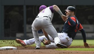 Atlanta Braves' Freddie Freeman, right, is caught stealing second base by Colorado Rockies shortstop Trevor Story during the first inning of a baseball game, Sunday, Aug. 27, 2017, in Atlanta. (AP Photo/John Amis)