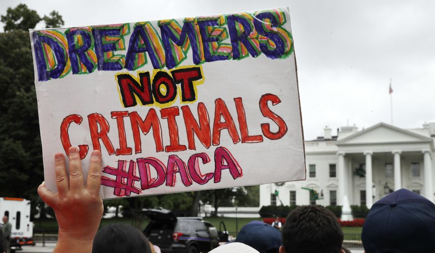 A woman holds up a signs in support of the Obama administration program known as Deferred Action for Childhood Arrivals, or DACA, during an immigration reform rally at the White House in Washington, Aug. 15, 2017. (AP Photo/Jacquelyn Martin) ** FILE **
