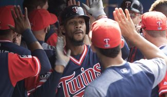 Minnesota Twins Byron Buxton celebrates in the dugout after hitting a a two-run home run off Toronto Blue Jays starting pitcher Joe Biagini during fourth-inning baseball game action in Toronto, Sunday, Aug. 27, 2017. (Chris Young/The Canadian Press via AP)