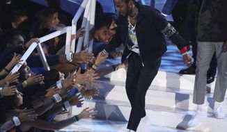"Kendrick Lamar accepts the award for video of the year for ""HUMBLE."" at the MTV Video Music Awards at The Forum on Sunday, Aug. 27, 2017, in Inglewood, Calif. (Photo by Matt Sayles/Invision/AP)"